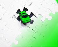 Green Car and Puzzle Stock Photography