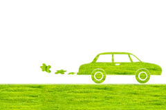 Green car symbol from grass background, isolated on white. Stock Photos