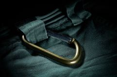 Green carabiner with climbing rope on rocky background. Climbing concept Royalty Free Stock Photos