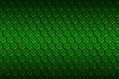 Green carbon fiber hexagon pattern. Stock Photos