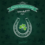 Green card for St. Patrick's Day with horseshoe and shamrock Royalty Free Stock Images