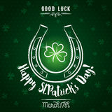 Green card for St. Patrick`s Day with   horseshoe and shamrock, Royalty Free Stock Photos