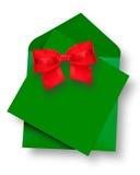 Green Card und Umschlag mit rotem Bogen Stockbilder