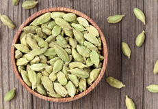 Green cardamom ayurveda plant spice in a wooden Stock Images