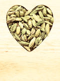 Green cardamom pods heart form Royalty Free Stock Image