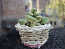 Green cardamom in bamboo basket. Picture of green cardamom in small bamboo basket royalty free stock photography