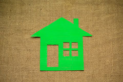 Green cardboard house on sackcloth Royalty Free Stock Images
