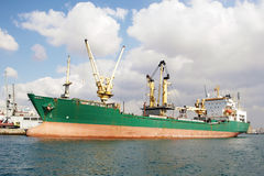 Green cargo ship Stock Images