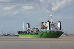 Green Cargo Ship. In the Mississippi River, port of New Orleans in the background Stock Photography