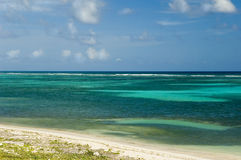 Green Caribbean Beach. The green waters off a tropical caribbean island picture a little bit of paradise Stock Image