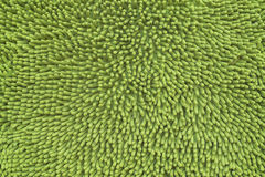 Green carpet design home. Mat worm green carpet design home Royalty Free Stock Photo