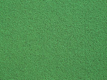 Green carpet or foot scraper. Background of green carpet or foot scraper royalty free stock photo