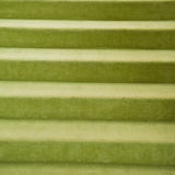 Green carpet stairs Stock Photography
