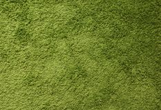 Green carpet. Surface imitating green grass. A close-up photograph. Top view Royalty Free Stock Photography