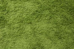Green carpet. Surface imitating green grass. A close-up photograph. Top view Stock Photography