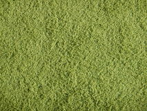 Green carpet texture with high hair Royalty Free Stock Photos