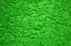 Green carpeted closeup Royalty Free Stock Photography