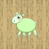 Green cartoon sheep on wood background. Card for Christmas and 2015 New Year of the Sheep, symbol of a Chinese horoscope Stock Image