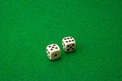 Green casino table with dice Royalty Free Stock Photos