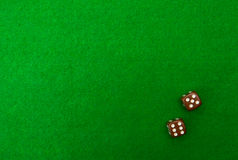 Green casino table with dice Royalty Free Stock Images
