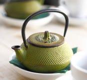 Green cast iron teapot Stock Photos