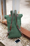 Green casual backpack standing on Industrial background Royalty Free Stock Photos