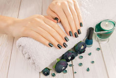 Green cat eye manicure Stock Photography