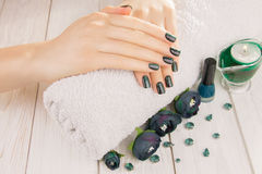 Green cat eye manicure Stock Image