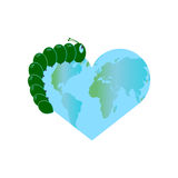 The green caterpillar crawls across the globe. A globe in the shape of a heart. World environment day. Stock Image