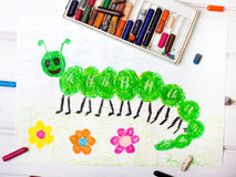 Green caterpillar with happy face. Colorful drawing: green caterpillar with happy face Stock Photos