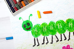 Green caterpillar with happy face. Colorful drawing: green caterpillar with happy face Royalty Free Stock Image