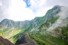 Green caucasus rocky mountain landscape, natural travel vacation background. stock photo