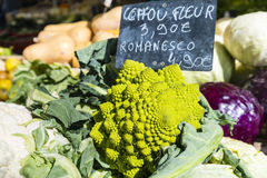 Green cauliflower with chalk sign on Paris market stall Stock Photos