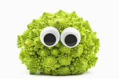Green cauliflower with googly eyes on white background. Cauliflower face Royalty Free Stock Images