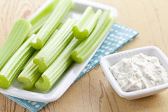Green celery sticks with tasty dip Stock Image