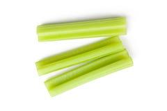 Green celery sticks on white background Stock Photos