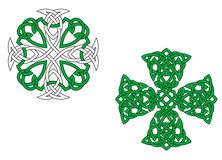 Green celtic crosses. Two green celtic crosses isolated on white background Stock Photos