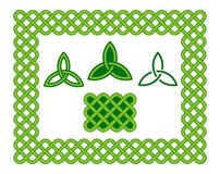 Green celtic style frame and design elements. Traditional green celtic style braided knot frame and triquetra design elements isolated over white. Irish St Royalty Free Stock Image