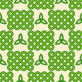 Green celtic style seamless pattern. Traditional green celtic style braided knots and triquetra symbols seamless pattern. Irish St. Patrick`s day vector Stock Image