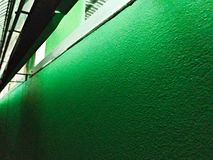 Green cement wall with night light stock photography