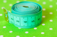 Green centimeter on a green background Stock Images