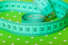 Green centimeter on a green background Royalty Free Stock Photo