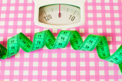 Green centimeter and  scales Stock Images