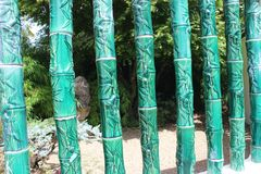 Green ceramic bamboo patterned vertical screen. Jade colored ceramic bamboo vertically arrange in a screen structure with bamboo leaf detailing Royalty Free Stock Photos