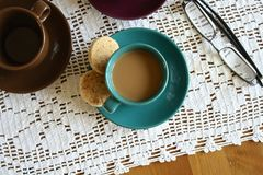 Green Ceramic Cup With Coffee Beside 2 Round Pastry stock images