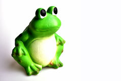 Green ceramic frog. On white Royalty Free Stock Images