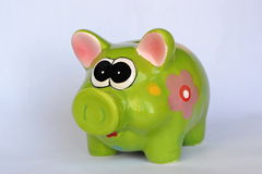 Green ceramic piggy bank with flowers Stock Photos