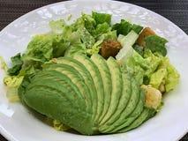 Cesar salad with sliced avocado stock photo