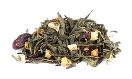 Green Ceylon tea with berries and fruits - apple, dog-rose, strawberry and cranberry, isolated on white background. Green Ceylon tea with berries and fruits stock photos