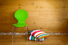 Green Chair and colorful pillows Stock Photo